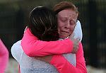 Savannah McCarthy, right, hugs Tracy Kelly after completing a memorial 5K walk and run in honor of the victims of the 2011 IHOP shooting in Carson City, Nev., on Friday, Sept. 6, 2013.  Kelly is the widow of Nevada National Guard Lt. Col. Heath Kelly who was one of four people killed when Eduardo Sencion opened fire in the restaurant before killing himself in the parking lot. Nine others were wounded in the attack.<br /> Photo by Cathleen Allison