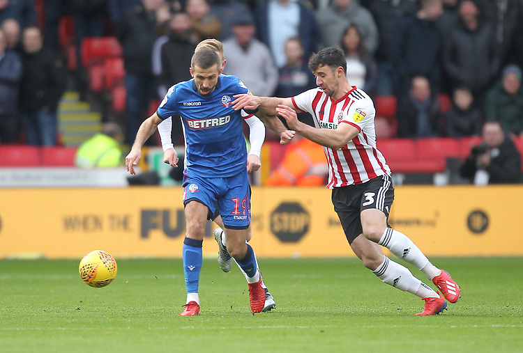 Bolton Wanderers Gary O'Neil battles with  Sheffield United's Enda Stevens<br /> <br /> Photographer Mick Walker/CameraSport<br /> <br /> The EFL Sky Bet Championship - Sheffield United v Bolton Wanderers - Saturday 2nd February 2019 - Bramall Lane - Sheffield<br /> <br /> World Copyright © 2019 CameraSport. All rights reserved. 43 Linden Ave. Countesthorpe. Leicester. England. LE8 5PG - Tel: +44 (0) 116 277 4147 - admin@camerasport.com - www.camerasport.com