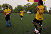 Brooklyn, New York<br /> April 25, 2010<br /> <br /> Brooklyn on a rainy Sunday in April.<br /> <br /> Hispanic men play soccer in Red Hook.