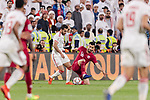 Bandar Mohamed Al Ahbabi of United Arab Emirates (L) fights for the ball with Boualem Khoukhi of Qatar (R) during the AFC Asian Cup UAE 2019 Semi Finals match between Qatar (QAT) and United Arab Emirates (UAE) at Mohammed Bin Zaied Stadium  on 29 January 2019 in Abu Dhabi, United Arab Emirates. Photo by Marcio Rodrigo Machado / Power Sport Images