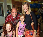 Shawn and Ann Burke with their daughters Blayne,9, and Bree,6, at the MD Anderson Back to School Fashion Show at The Galleria Saturday August 17, 2013.(Dave Rossman photo)