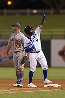AFL West catcher Meibrys Viloria (9), of the Surprise Saguaros and Kansas City Royals organization, celebrates in front of Peter Alonso (20) after hitting a single during the Arizona Fall League Fall Stars game at Surprise Stadium on November 3, 2018 in Surprise, Arizona. The AFL West defeated the AFL East 7-6 . (Zachary Lucy/Four Seam Images)