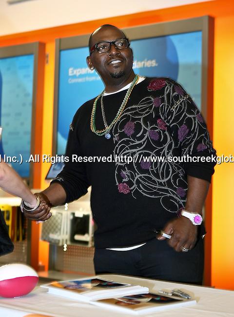 American Idol judge Randy Jackson signs autographs before Super Bowl XLV in Arlington,Texas.