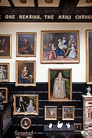 16th and 17th century portraits in the great staircase hall. Above, one can see part of the motto taken from Shelly's Adonais which encircles the room