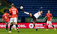 Bolton Wanderers' Antoni Sarcevic (centre) gets to the ball first<br /> <br /> Photographer Andrew Kearns/CameraSport<br /> <br /> The EFL Sky Bet League Two - Bolton Wanderers v Salford City - Friday 13th November 2020 - University of Bolton Stadium - Bolton<br /> <br /> World Copyright © 2020 CameraSport. All rights reserved. 43 Linden Ave. Countesthorpe. Leicester. England. LE8 5PG - Tel: +44 (0) 116 277 4147 - admin@camerasport.com - www.camerasport.com