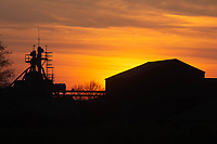 19-4-2021 Sunsetting behind a farm grain store <br /> ©Tim Scrivener Photographer 07850 303986<br />      ....Covering Agriculture In The UK....