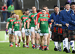 Martin Mc Mahon, captain of Kilmurry Ibrickane, leads his team behind the band before their senior county final against Clondegad at Cusack park. Photograph by John Kelly.