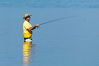 A fisherman tries his luck in the water off of East Beach in Fort Desoto Park