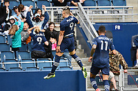 KANSAS CITY, KS - MAY 16: Alan Pulido #9 Sporting KC celebrates his second goal during a game between Vancouver Whitecaps and Sporting Kansas City at Children's Mercy Park on May 16, 2021 in Kansas City, Kansas.