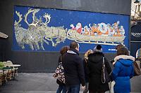 """Europe/ Ile de France / Paris /75011 :  Œuvre de  l'artiste No More Lies » Il s'agit d'un collage, réalisé la veille de Noël, où l'on peut voir un père Noël dans son traîneau tiré par des rennes. A la place des cadeaux, il transporte des migrants syriens histoire de nous rappeler qu'en cette période de fêtes, ce n'est pas le cas pour tous  -, Sur Le mur d'Oberkampf, ce pari fou devenu une institution du street art parisien  sur l'immeuble de l'historique Café Charbon, L'association le M.U.R. (modulable, urbain, réactif)  Oeuvre Protégée  //  Europe / Ile de France / Paris / 75011:  <br /> Work of the artist No More Lies """"It is about a collage, carried out on Christmas Eve, where one can see a Santa Claus in his sleigh pulled by reindeer. Instead of gifts, he carries Syrian migrants to remind us that during this holiday season, this is not the case for everyone. - The Oberkampf wall, this crazy gamble that has become an institution of Parisian street art on the building of the historic Café Charbon, The association M.U.R. (modular, urban, reactive)  OP Protected work /"""