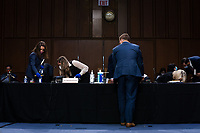 Staffers clean the witness table during the fourth day of the confirmation hearing for Judge Amy Coney Barrett, President Donald Trump's Nominee for Supreme Court, in Hart Senate Office Building in Washington DC, on October 15th, 2020.<br /> Credit: Anna Moneymaker / Pool via CNP /MediaPunch