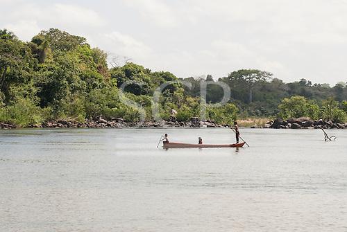Pakissamba Village (Juruna), Xingu River, Para State, Brazil. Children in a canoe.