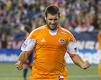 Houston Dynamo forward Will Bruin (12) celebrates scoring a goal.  The New England Revolution played to a 1-1 draw against the Houston Dynamo during a Major League Soccer (MLS) match at Gillette Stadium in Foxborough, MA on September 28, 2013.
