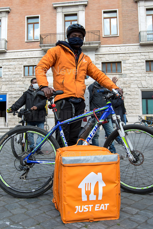 Rome, Italy. 26th Mar, 2021. Strike held in Rome by food delivery riders who call the Internet food delivery platforms to provide contracts, better working condition and better payment. The strike has took place in about 30 cities across Italy.