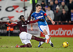 Lee Wallace tackled by Esmael Goncalves