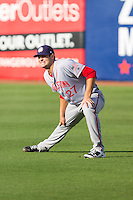 Hagerstown Suns starting pitcher Lucas Giolito (27) stretches in the outfield prior to the game against the Greensboro Grasshoppers at NewBridge Bank Park on June 21, 2014 in Greensboro, North Carolina.  The Grasshoppers defeated the Suns 8-4. (Brian Westerholt/Four Seam Images)