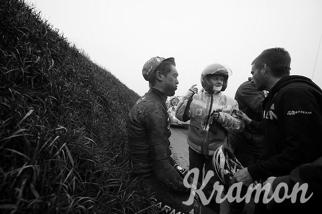 Dwars Door Vlaanderen 2013.Jack Bauer (NZL) dazed by the roadside after crashing hard on the Ladeuze descent