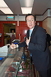 David Cameron, the Conservative Party leader inside Hugh Evans the butchers shop in Carmarthen as he toured the area and spoke to local businesses during his visit to South Wales today..The Conservatives want to introduce a bill demanding compulsory country of origin labelling, which will require products carrying the UK flag to be born, reared and processed in Britain...