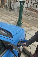 - first recharge station for electric cars in Milan, Citroen of a car sharing company....- prima stazione di ricarica per automobili elettriche a Milano, auto Citroen di una compagnia di car sharing