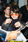 American singer and actress Selena Gomez signs autographs for fans upon her arrival at Tokyo International Airport on August 1, 2016, Tokyo, Japan. After performing in the Philippines Gomez came to Japan for the first time in two years as part of her ''Revival'' world tour. Gomez will perform at the Tokyo International Forum on August 2 and 3. (Photo by Rodrigo Reyes Marin/AFLO)