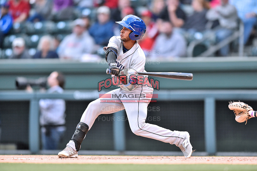 Asheville Tourists second baseman Carlos Herrera (4) swings at a pitch during a game against the Greenville Drive at Fluor Field on April 7, 2016 in Greenville South Carolina. The Drive defeated the Tourists 4-3. (Tony Farlow/Four Seam Images)