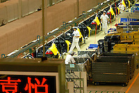 Workers on the production line of the Honda Accord at the new Guangzhou Honda Automobile Co. Ltd. factory. The plant built at a cost of 140 million US$ is one of the most advanced car plants in the world. It has a state of the art production line as well as the world's first total water re-cycling sytem.