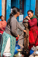Nepal, Patan.  Women Talking at Public Water Pump.