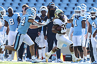 CHAPEL HILL, NC - NOVEMBER 14: Christian Beal-Smith #26 of Wake Forest is chased by Welton Spottsville #44 of North Carolina during a game between Wake Forest and North Carolina at Kenan Memorial Stadium on November 14, 2020 in Chapel Hill, North Carolina.