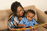 2 year old boy with mother at home read to language development pointing
