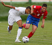 Jordan Cousins (L) of England compete for the ball with Dejan Maleg of Serbia during the UEFA U-17 championship Group A match between Serbia and England on May 9, 2011 in Indjija, Serbia (Photo by Srdjan Stevanovic/Starsportphoto.com)
