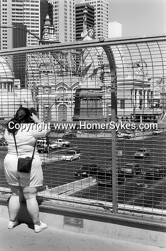 """Las Vegas Nevada 2001. A city of dreams an all American woman takes a photograph of the """"Statue of Liberty"""" in down town Las Vegas."""
