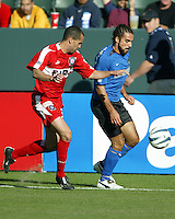 Evan Whitfield (red) and Dwayne DeRosario (blue) chase after a loose ball during MLS Cup 2003.  The San Jose Earthquakes defeated the Chicago Fire 4-2 in the MLS Championship at The Home Depot Center on November 23, 2003.