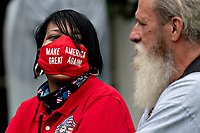 """An attendee wears a """"Make America Great Again"""" protective mask during a Rolling to Remember ceremony honoring the nation's veterans and prisoners of war/missing in action (POW/MIA) in Washington, D.C., U.S., on Friday, May 22, 2020. United States President Donald J. Trump didn't wear a face mask during most of his tour of Ford Motor Co.'s ventilator facility Thursday, defying the automaker's policies and seeking to portray an image of normalcy even as American coronavirus deaths approach 100,000. <br /> Credit: Andrew Harrer / Pool via CNP/AdMedia"""