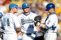 UCLA starting pitcher Gerrit Cole meets with catcher Steve Rodriguez and 3B Dean Espy  in Game One of the NCAA Division One Men's College World Series Finals on June 28th, 2010 at Johnny Rosenblatt Stadium in Omaha, Nebraska.  (Photo by Andrew Woolley / Four Seam Images)