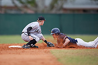 Edgewood Eagles second baseman Bryan Niznik (2) tags Marcus Krupke out on a stolen base attempt during the first game of a double header against the Bethel Wildcats on March 15, 2019 at Terry Park in Fort Myers, Florida.  Bethel defeated Edgewood 6-0.  (Mike Janes/Four Seam Images)