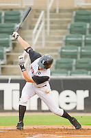 Nicholas Ciolli #20 of the Kannapolis Intimidators fouls a ball of his thigh against the Hickory Crawdads at Fieldcrest Cannon Stadium August 17, 2010, in Kannapolis, North Carolina.  Photo by Brian Westerholt / Four Seam Images