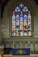 UK, England, Cambridge.  Corpus Christi College Chapel, Stained Glass Showing the Crucifixion of Jesus.