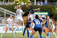 CARY, NC - SEPTEMBER 12: Lindsey Horan #10 of the Portland Thorns heads the ball during a game between Portland Thorns FC and North Carolina Courage at Sahlen's Stadium at WakeMed Soccer Park on September 12, 2021 in Cary, North Carolina.