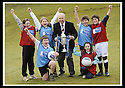 24/02/2009  Copyright Pic: James Stewart.File Name : sct_jspa08_scottis_cup.FORMER FALKIRK LEGEND ALEX TOTTEN SHOWS OFF THE HOMECOMING SCOTLAND SCOTTISH CUP TO (l to r rear) REBECCCA LEWIS, SARAH JOHNSTON, IAN MCARTHUR, ROSS ANDERSON (l to r front) STUART IRVINE AND CAITLIN MUNGALL, PRIMARY SEVEN PUPILS AT ST MARGARET'S PRIMARY SCHOOL, POLMONT......Press Release..... A unique interactive tour to engage primary school children with football and the Homecoming Scottish Cup rolls into town today, Tuesday 24 February 2009 at St Margaret's Primary School in Falkirk.  . .Up to 100 pupils in primaries 5 to 7 at each local school will receive specialist skills and drill training from Scottish Football Association coaches as well as getting the chance to view the Homecoming Scottish Cup trophy itself.. .The school tour takes the form of a giant 'football-shaped' tent, which houses the world's oldest footballing trophy and information about Homecoming Scotland and the Scottish Cup tournament.. .Future football stars will be given soccer skills training ahead of watching their home team, Falkirk, take on Inverness Caledonian Thistle in the quarter finals of the Homecoming Scottish Cup on the weekend of 7 March.. .Falkirk legend Alex Totten, who used to manage the side, will be on hand at St Margaret's Primary School to share his knowledge and experience with the kids and to see the trophy himself.. .All primary schools in Scotland will also be sent education packs to encourage pupils to know more about Homecoming Scotland and to learn more about healthy eating, fitness and playing football as a way to keep fit and have fun.  . .As part of the football celebrations, the tour will then encourage locals in the town centre to get behind their local team, when the cup visits The Mall in Falkirk later in the afternoon.. .The Homecoming Scottish Cup Tour has been designed to engage with Scotland's local communities and spread the message about joining in the celebrations for Homecomi