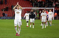 Pictured: federico Fernandez of Swansea thanks away supporters Sunday 01 February 2015<br />