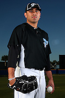 March 1, 2010:  Pitcher Ricky Romero (24) of the Toronto Blue Jays poses for a photo during media day at Englebert Complex in Dunedin, FL.  Photo By Mike Janes/Four Seam Images