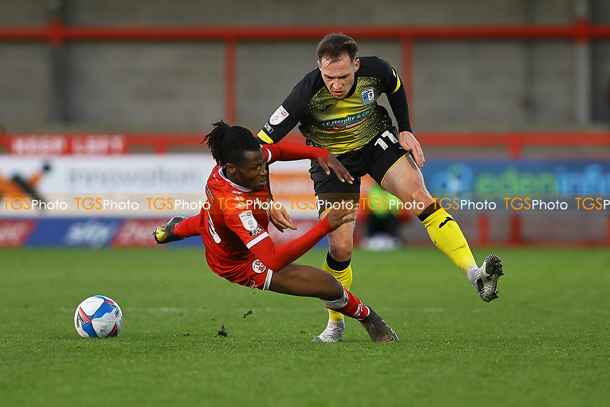 Josh Kay of Barrow AFC clashes with David Sesay of Crawley Town during Crawley Town vs Barrow, Sky Bet EFL League 2 Football at Broadfield Stadium on 12th December 2020