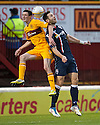 Motherwell's Jamie Murphy and County's Mihael Kovacevic challenge for the ball...