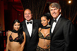 """Belly dancer """"Zylona' played by Nicole Hanveya, chair MarkGrierson, """"Sahira"""" played by Alesha Herrera and chair Mike Plank at the Children's Museum """"Arabian Nights"""" Gala at The Corinthian Saturday  Oct. 14,2006.(Dave Rossman/For the Chronicle)<br />"""