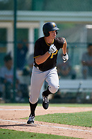 Pittsburgh Pirates center fielder Bryan Reynolds (5) runs to first base during a Florida Instructional League game against the Detroit Tigers on October 2, 2018 at the Pirate City in Bradenton, Florida.  (Mike Janes/Four Seam Images)