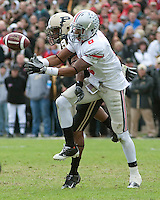 Purdue cornerback David Pender defends Ohio State wide receiver DeVier Posey (#8 in white). The Purdue Boilermakers defeated the Ohio State Buckeyes 26-18 at Ross-Ade Stadium, West Lafayette, Indiana on October 17, 2009..