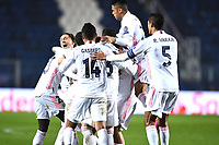 Ferland Mendy of Real Madrid celebrates with team mates after scoring the goal of 0-1 during the Champions League round of 16 football match between Atalanta BC and Real Madrid at Atleti azzurri d'Italia stadium in Bergamo (Italy), February, 24th, 2021. Photo Image Sport  / Insidefoto