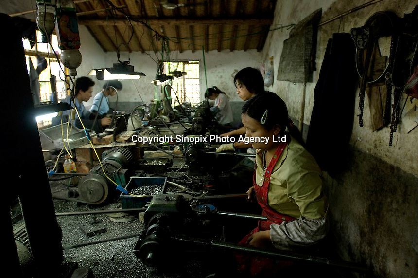 Chinese workers, mostly from western China,  produces metal components for export in a private metal work factory in coastal Ningbo, Zhejiang province, China.  .