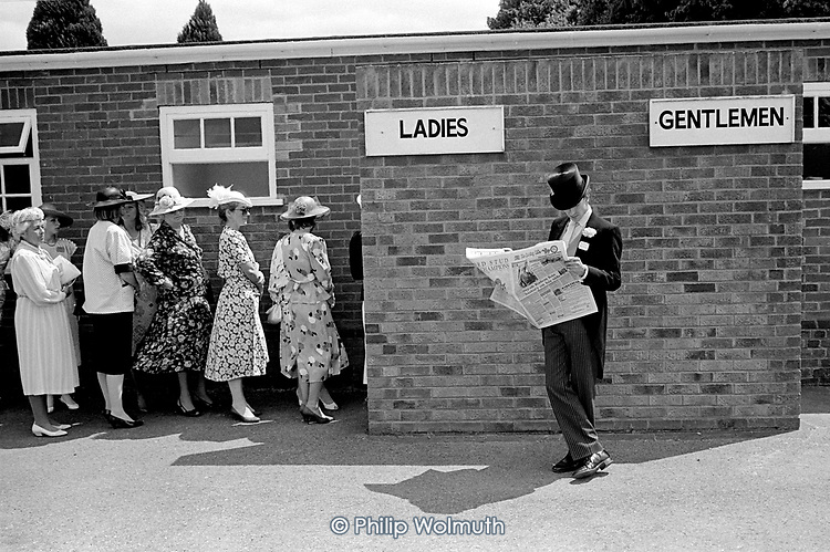 Women queue to use the Ladies during Royal Ascot week at Ascot race-course.