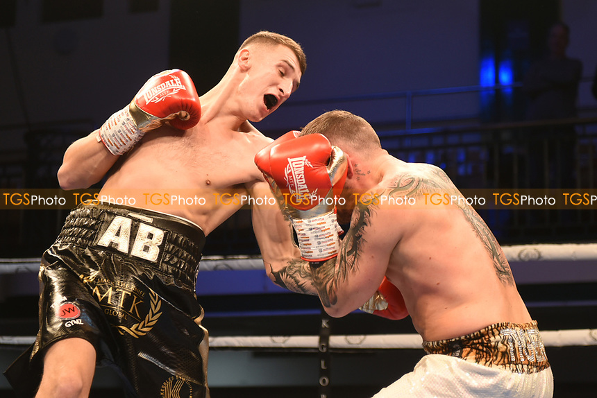 Alex Bellingham (black shorts) defeats Carl Turney during a Boxing Show at York Hall on 9th November 2019